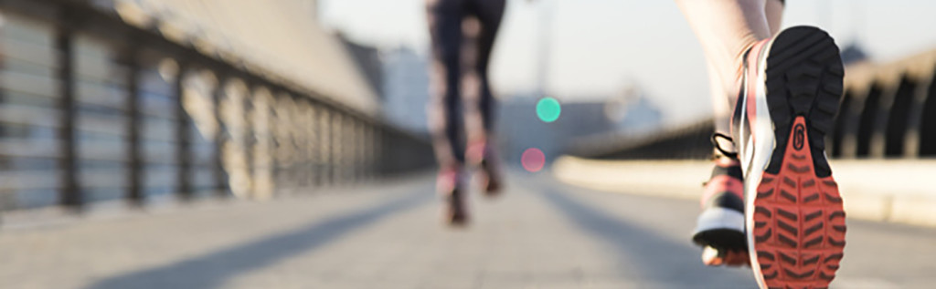 close-up-of-woman-running-with-unfocused-background_23-2147600468